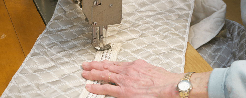 At The Beloit Mattress Company we hand stuff and hand stitch every mattress topper, then inspect it to perfection