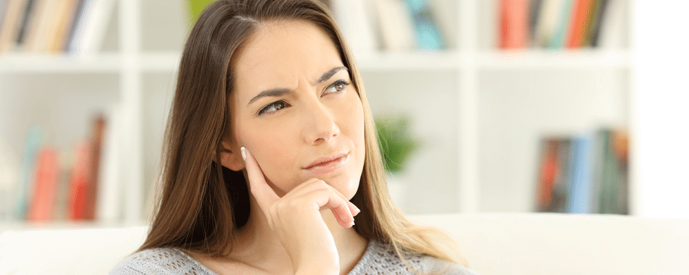 "Woman wondering ""where can I find a great mattress topper near me"""