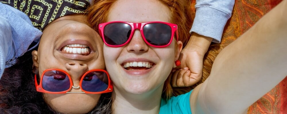 two girls in a sun glasses