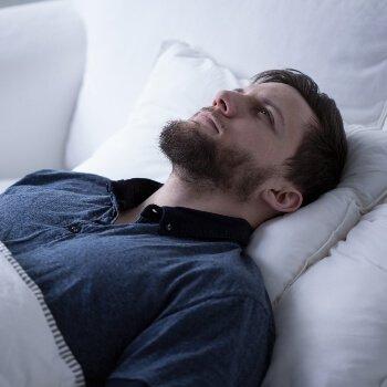 Guy-lying-awake