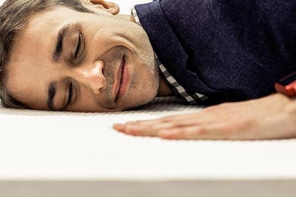 man laying on memory foam mattress