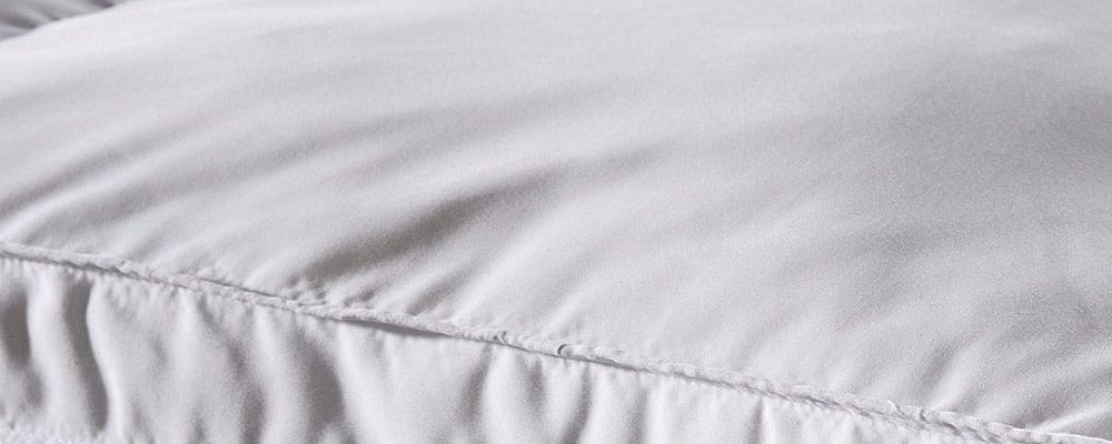 how to clean a down mattress topper