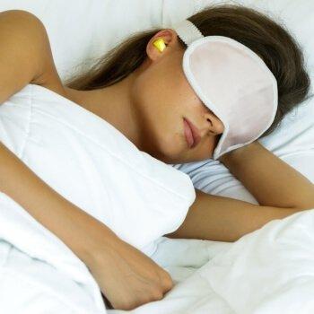 Lady sleeping with eye shades