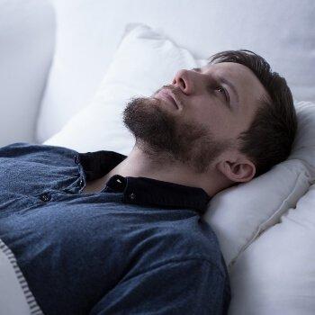 Man Laying Awake