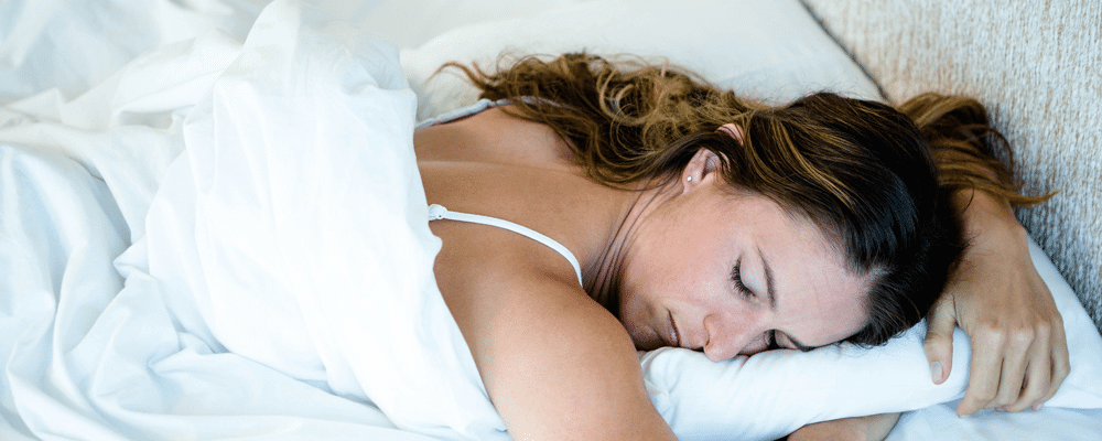 Woman Sleeping uncomfortable while sleeping in her Stomach