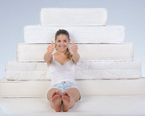 Woman and multiple mattresses
