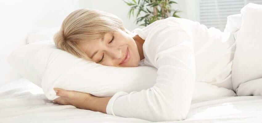 Woman Sleeping with Beliot Best mattress topper for stomach sleepers